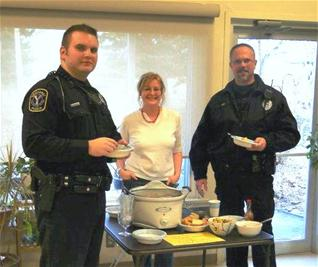 2 police officers and a woman eating lunch